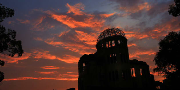 The Atomic Bomb Dome is silhouetted at sunset in Hiroshima, western Japan,  Monday, Aug. 5, 2013. Hiroshima marks the 68th anniversary of the world's first atomic bombing Tuesday.(AP Photo/Shizuo Kambayashi)