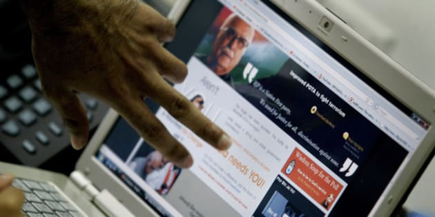 Web designer's fingers are seen as they discuss a web page of India's opposition Bharatiya Janata Party's (BJP) prime ministerial nominee Lal Krishna Advani at BJP's Information Technology Cell, in New Delhi, India, Thursday, April 9, 2009. India will hold general elections in five phases beginning April 16. (AP Photo/Gemunu Amarasinghe)