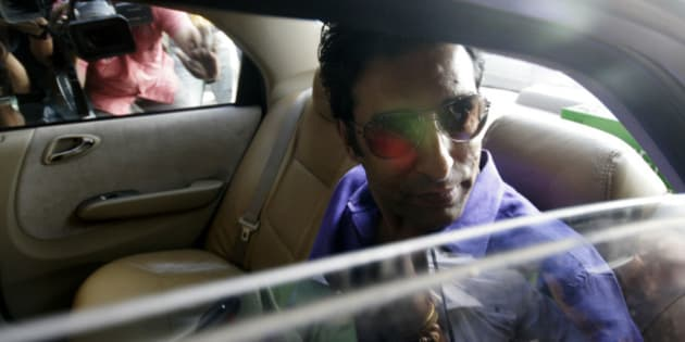 Former Pakistan cricket captain Wasim Akram arrives for a meeting with Indian Premier League team Kolkata Knight Riders owner and Bollywood actor Shah Rukh Khan in Mumbai, India, Sunday, Aug.30, 2009. Akram is one of the leading contenders for the job of the coach of the Knight Riders. (AP Photo/Dhiraj Singh)