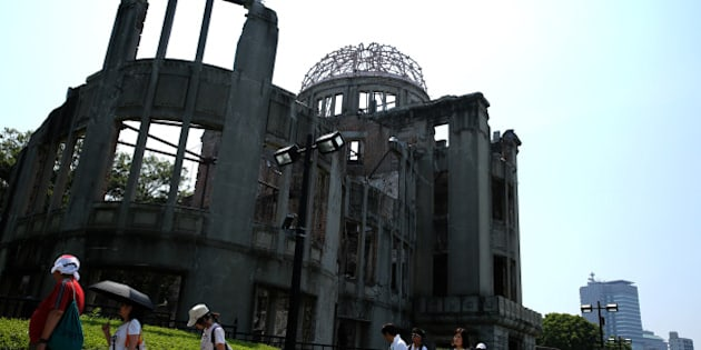 HIROSHIMA, JAPAN - AUGUST 05:  People walk past the Atomic Bomb Dome at the Hiroshima Peace Memorial Park on one day before the 70th anniversary of the atomic bombing of Hiroshima on August 5, 2015 in Hiroshima, Japan. Japan marks the 70th anniversary of the first atomic bomb that was dropped by the United States on Hiroshima on August 6, 1945, killing an estimated number of 70,000 people instantly, with many tens of thousands more dying over the following years from the effects of radiation. Three days later another atomic bomb was dropped on Nagasaki, ending World War II.  (Photo by Buddhika Weerasinghe/Getty Images)