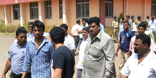 Member of Parliament of the 14th Lok Sabha of India and member of the Indian National congress party Churchill Alemao (2R) leaves the counting centre during state elections in Margao, Goa on March 6, 2012. Congress lost heavily in the holiday state Goa, where it had been in power, and was struggling to regain the agricultural heartland of Punjab and the mountainous northern state of Uttarakhand. AFP PHOTO (Photo credit should read STRDEL/AFP/Getty Images)