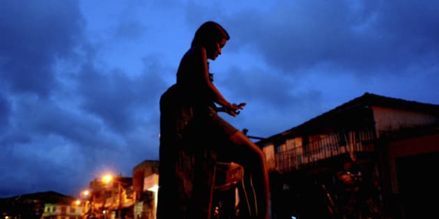 **APN ADVANCE FOR SUNDAY SEPT. 21**  A prostitute waits for clients at a street , in Abaetetuba, Para state, Brazil, May 10, 2008. When the Brazilian media discovered  that a 15-year-old girl had been locked up for weeks in a cell with 21 men, who only allowed her to eat in return for sex, it set off a national scandal. But it came as little surprise to social workers in this Amazon port city that sits along a major cocaine shipment route, where education is scarce and legitimate work hard to come by. (AP Photo/Renato Chalu)