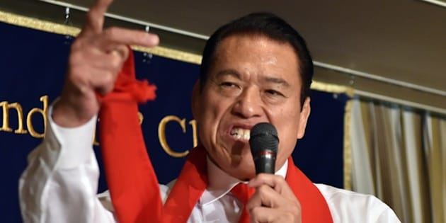 Former professional wrestler and Japan's Upper House member Antonio Inoki shouts at a press conference in Tokyo on August 21, 2014. Inoki will visit Pyongyang to promote a professional wrestling event at the end of August.   AFP PHOTO / Yoshikazu TSUNO        (Photo credit should read YOSHIKAZU TSUNO/AFP/Getty Images)