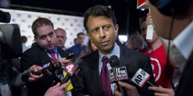 Bobby Jindal, governor of Louisiana and 2016 Republican presidential candidate, speaks to the media in the spin area after a televised forum ahead of the first Republican presidential debate at Quicken Loans Arena in Cleveland, Ohio, U.S., on Thursday, Aug. 6, 2015. Seven candidates in the forum, hosted by Fox News and Facebook Inc. in conjunction with the Ohio Republican Party, were omitted from the prime-time debate stage after they didn't make the top 10 of an average of the five most recent national polls as recognized by Fox News. Photographer: Andrew Harrer/Bloomberg via Getty Images