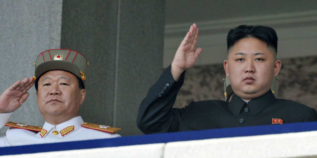 In this photo taken on April 15, 2012, North Korean leader Kim Jong Un, right, and Vice Marshal Choe Ryong Hae salute during a mass military parade in Kim Il Sung Square to celebrate the centenary of the birth of his grandfather, national founder Kim Il Sung in Pyongyang, North Korea. (AP Photo/Kyodo News) JAPAN OUT, MANDATORY CREDIT
