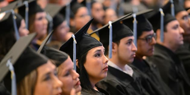 IMAGE DISTRIBUTED FOR PEARSON - The 2015 graduating class of Texas Southmost College listens as John Fallon, the CEO of Pearson, delivers their commencement address in Brownsville, Texas, Saturday, May 16, 2015. Fallon spoke about the idea that the new American Dream is powered by education, and is attainable regardless of socioeconomic status or location. (Brad Doherty/AP Images for Pearson)