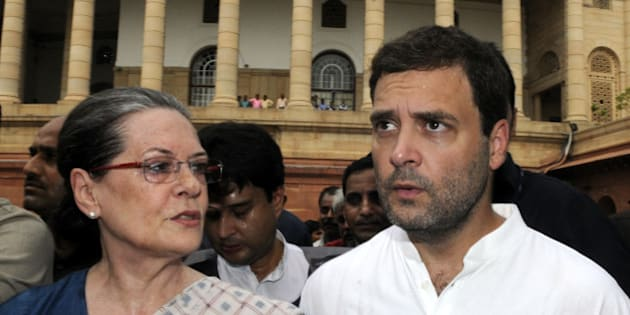 NEW DELHI, INDIA - AUGUST 4: Congress President Sonia Gandhi, and Congress Vice President Rahul Gandhi after protest against the NDA Government at the Gandhi Statue of Parliament complex in New Delhi, India on Tuesday. August 4, 2015, Congress party members are protesting against the suspension of their 25 members by the Lok Sabha Speaker. (Photo By Sonu Mehta/Hindustan Times via Getty Images)