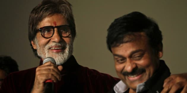 """Indian actor Amitabh Bachchan, left, and Telugu film industry super star Chiranjeevi address the media during the premiere of Bachchan's latest movie """"Bbuddah Hoga Terra Baap"""" in Hyderabad, India, Thursday, June 30, 2011. (AP Photo/Mahesh Kumar A.)"""