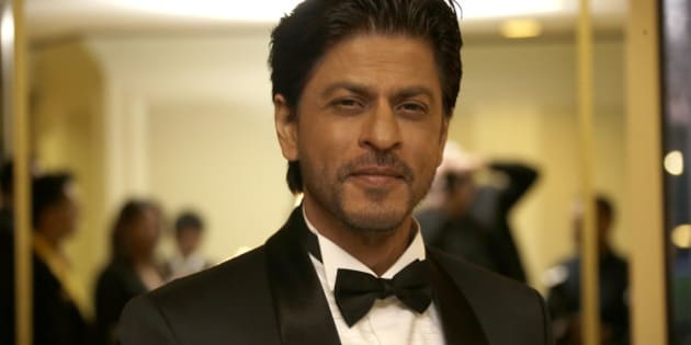 Shah Rukh Khan poses for photographers upon arrival at The Asian Awards in central London, Friday, 17 April, 2015. (Photo by Joel Ryan/Invision/AP)