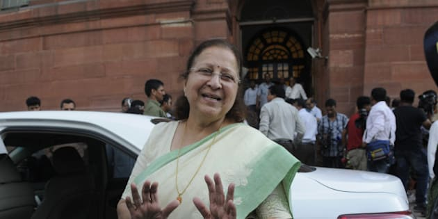 NEW DELHI, INDIA - AUGUST 3: Lok Sabha Speaker Sumitra Mahajan coming out after talking to media persons about the suspension of the 27 MPs after the session was adjourned during the Monsoon Session at the Parliament House, on August 3, 2015 in New Delhi, India. 25 of Congress party's 44 members in Lok Sabha were today suspended for five days for causing disruptions, setting the stage for escalation in confrontation as nine opposition parties decided to boycott the House for these days to express solidarity with the suspended members. (Photo by Sushil Kumar/Hindustan Times via Getty Images)