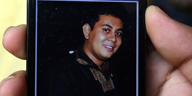 A photograph of Bangladeshi blogger Niloy Chakrabarti, who used the pen-name Niloy Neel, 40, is seen on a cellular phone in Dhaka on August 7, 2015. A gang armed with machetes hacked a secular blogger to death at his home in Dhaka August 7, 2015, sparking protests in the capital over the fourth such murder in Bangladesh this year.  AFP PHOTO        (Photo credit should read STR/AFP/Getty Images)