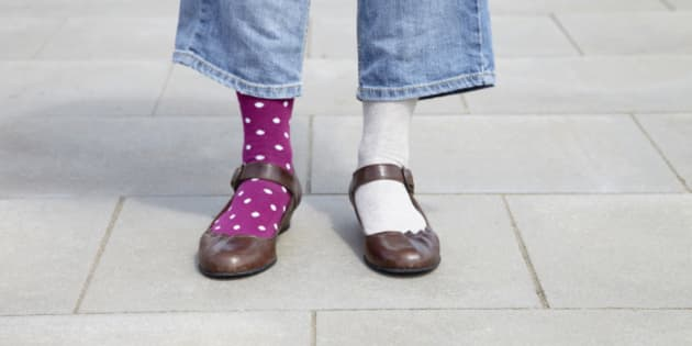 detail of woman wearing different socks