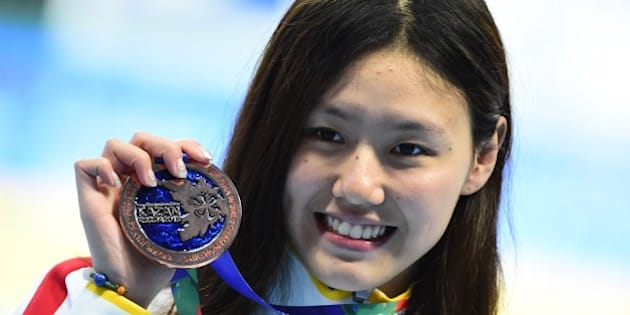 China's Liu Xiang poses with her bronze medal during the podium ceremony for the women's 50m backstroke swimming event at the 2015 FINA World Championships in Kazan on August 6, 2015.  AFP PHOTO / ALEXANDER NEMENOV        (Photo credit should read ALEXANDER NEMENOV/AFP/Getty Images)