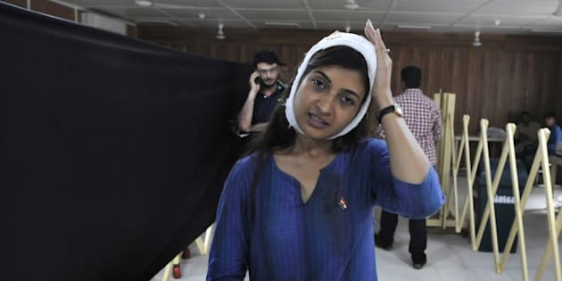 NEW DELHI, INDIA - AUGUST 9: AAP MLA from Chandni Chowk Alka Lamba during a press conference after she was injured during her anti-drug addiction campaign in north Delhi's Kashmere Gate area on Sunday morning, on August 9, 2015 in New Delhi, India. Lamba started an anti-drug drive at 5 a.m. from Yamuna Bazar to mark the Quit India Movement Day. She alleged that the incident was a conspiracy against her anti-drug drive and urged the police to conduct a fair probe into the matter. She received head injuries and was rushed to Aruna Asaf Ali Hospital, where she was discharged after treatment. (Photo by Sushil Kumar/Hindustan Times via Getty Images)