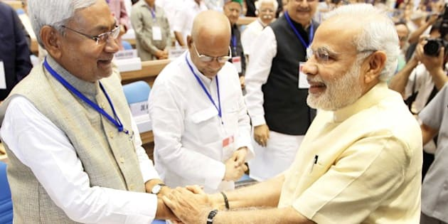 NEW DELHI, INDIA - APRIL 5: Prime Minister Narendra Modi and Chief Minister of Bihar Nitish Kumar during the joint conference of the Chief Ministers and the Chief Justices of High Courts at Vigyan Bhawan, on April 5, 2015 in New Delhi, India. Talking about judicial system, Modi said that what the people in judicial system do is divine and God has sent them to carry out this divine responsibility. We are going on increasing our power. But We also need to remember to become perfect even as we get more powerful. He urged the need for judges to evolve an in-built mechanism of self-correction to prevent rot from within. He further said that the common men's expectation from the judiciary is huge.(Photo by Arvind Yadav/Hindustan Times via Getty Images)