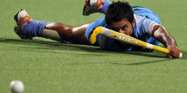 Gurbaj Singh of India watches the ball as he slips on the ground against Malaysia during the field hockey semi-final at the 16th Asian Games in Guangzhou on November 23, 2010. Malaysia defeated India in an extra time by 4-3 and qualified for final. AFP PHOTO / Saeed Khan (Photo credit should read SAEED KHAN/AFP/Getty Images)