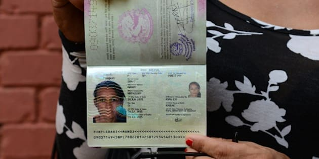 Nepalese transgender and the first recipient of a Nepalese transgender passport, Monica Shahi from Kailali district displays her new passport with 'O' for other in the document's gender section, in Kathmandu on August 10, 2015.  Nepal handed over its first transgender passport on August 10, no longer restricting the country's third gender population to describe themselves as male or female in their travel documents.  AFP PHOTO/ Prakash MATHEMA        (Photo credit should read PRAKASH MATHEMA/AFP/Getty Images)