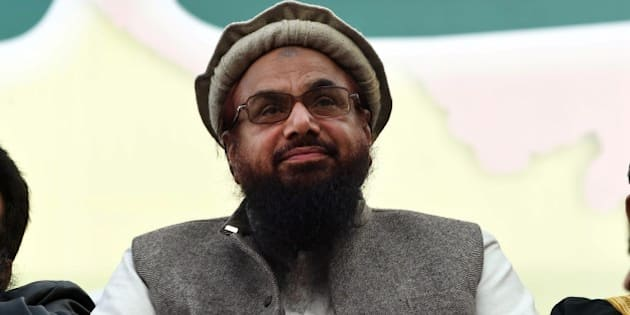 Hafiz Muhammad Saeed (C), head of the banned Pakistani charity organisation, Jamaat-ud-Dawa (JuD) attends a protest to mark Kashmir Solidarity day in Lahore on February 5, 2015. Pakistan observed Kashmir Solidarity Day on February 5 to denounce Indian rule in the disputed Himalayan region, claimed in whole by both countries.  AFP PHOTO / ARIF ALI        (Photo credit should read Arif Ali/AFP/Getty Images)