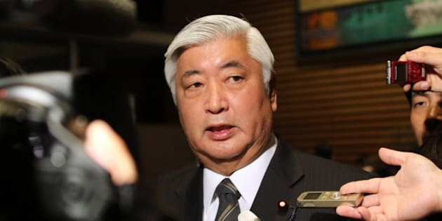 Japanese Defense Minister Gen Nakatani speakes to reporters after a cabinet meeting at the prime minister's official residence in Tokyo on January 25, 2015. Japan's government said it was attempting to verify a video posted online announcing the execution of one of two Japanese hostages held captive by Islamic State militants. 'A new video apparently showing Kenji (Goto) was posted on the Internet,' chief government spokesman Yoshihide Suga said. 'We are collecting information'.  AFP PHOTO / Yoshikazu TSUNO        (Photo credit should read YOSHIKAZU TSUNO/AFP/Getty Images)