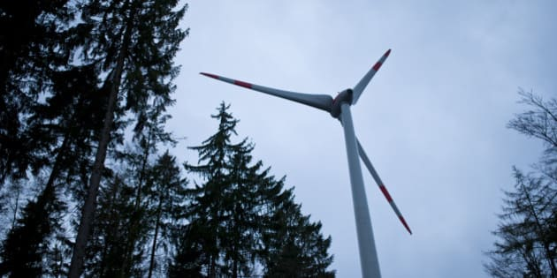 MARKT BERATZHAUSEN, GERMANY - OCTOBER 29: A wind turbine Enercon 101 is located in the forest Brenntenberg behind trees  on October 29, 2013 in Markt Beratzhausen, Germany.