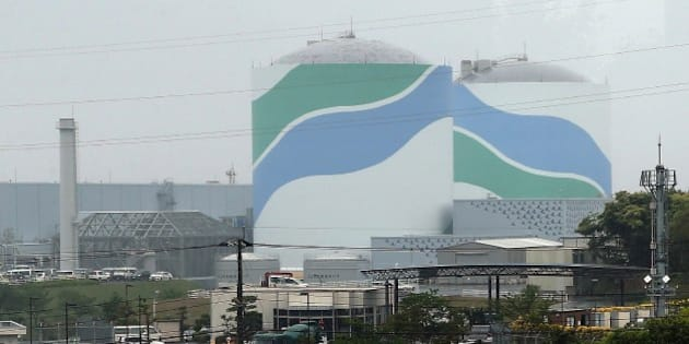 This picture taken on April 28, 2014 shows the Sendai nuclear power plant in Kagoshima prefecture. Japan's nuclear regulator said on July 16 that two atomic reactors were safe enough to switch back on, marking a major step towards restarting atomic plants that were shuttered after the Fukushima crisis. Nuclear Regulatory Authority (NRA) officials issued a more than 400 page report on the Sendai plant in southern Japan, technically giving its operator the green light to switch on its reactors -- the first since Japan ushered in tougher safety guidelines last year.  JAPAN OUT       AFP PHOTO / JIJI PRESS        (Photo credit should read JIJI PRESS/AFP/Getty Images)