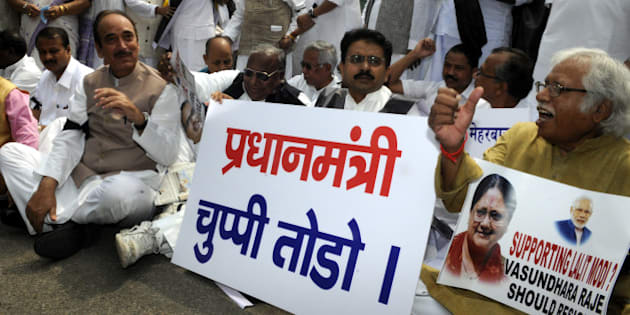 NEW DELHI, INDIA - AUGUST 5: Congress Party members from Rajya Sabha and Lok Sabha shout slogans against Prime Minister Narendra Modi and the NDA government during a protest led by Congress President Sonia Gandhi, former Prime Minister Manmohan Singh at Parliament House on August 5, 2015 in New Delhi, India. Congress and some opposition parties on Wednesday persisted with their protest against the suspension of 25 MPs as the stalemate in the Rajya Sabha continued over the opposition demand for the resignations of three BJP leaders. (Photo by Sonu Mehta/Hindustan Times via Getty Images)
