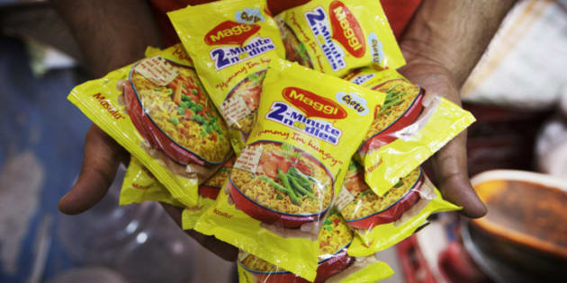 Packets of Maggi 2-Minute Noodles, manufactured by Nestle India Ltd., which were located behind the counter at a store are displayed for a photograph in New Delhi, India, on Monday, June 15, 2015. Nestle SA said the U.S. Food and Drug Administration is testing samples of imported Maggi noodles after the worlds largest food company halted sales in India when regulators said they contained unhealthy levels of lead. Photographer: Kuni Takahashi/Bloomber