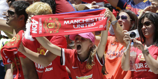 Manchester United fans cheer before an International Champions Cup soccer match between Manchester United and FC Barcelona in Santa Clara, Calif., Saturday, July 25, 2015. (AP Photo/Jeff Chiu)