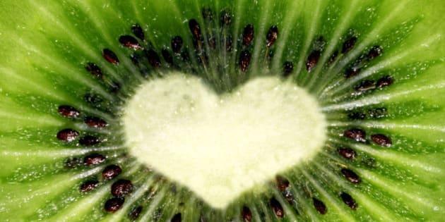 Macro section of kiwi shaped heart with vivid colors.