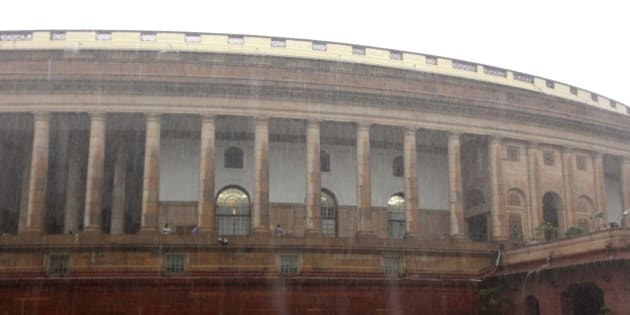 NEW DELHI, INDIA - AUGUST 11: Heavy rain at Parliament House during the monsoon session on August 11, 2015 in New Delhi, India. The lower house saw noisy scenes till its adjournment for the day in the post-lunch session with members from the treasury benches also intermittently raising slogans against Congress leaders. (Photo by Arvind Yadav/ Hindustan Times via Getty Images)