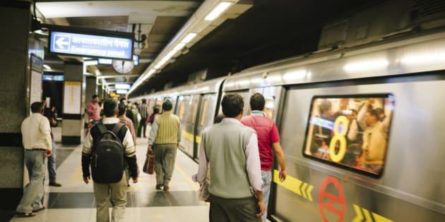 People on a subway station platform, New Delhi