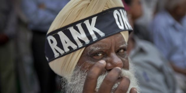 A former Sikh army soldier wears a headband around his turban during a protest in New Delhi, India, Sunday, July 26, 2015. The former soldiers are protesting against the delay in implementing the 'One Rank One Pension' scheme by the Indian government. (AP Photo/Tsering Topgyal)