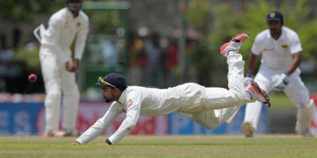 India's Virat Kohli dives to field a ball during the third day of the first cricket test match between India and Sri Lanka in Galle, Sri Lanka, Friday, Aug. 14, 2015. (AP Photo/Eranga Jayawardena)