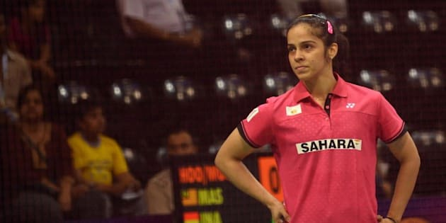In this photograph taken on March 25, 2015, Saina Nehwal of India reacts during her women's badminton singles match against Riay Mukherjee of India at the Yonex-Sunrise India Open 2015 at the Siri Fort Sports Complex in New Delhi. Badminton star Saina Nehwal has shrugged off mounting pressure over whether she will become the first Indian woman ever to clinch the world number one ranking, at the Indian Open in New Delhi. Nehwal, currently number two after reaching the prestigious All-England Championship final this month, is expected to snatch the number one spot if she wins the tournament in front of a home crowd.  AFP PHOTO / SAJJAD HUSSAIN        (Photo credit should read SAJJAD HUSSAIN/AFP/Getty Images)