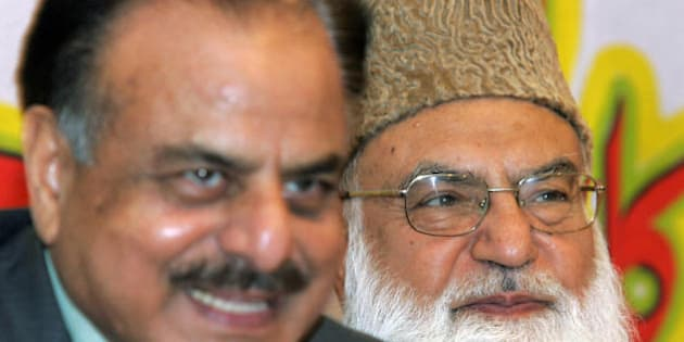 Leader of Pakistan?s hardline Muttahida Majlis-e-Amal (MMA) Qazi Hussain Ahmed (R) sits with former Inter Service Intelligence (ISI) chief Hamid Gul during his book launch ceremony in Islamabad, 03 September 2007.  Ahmed said we will welcome deposed prime minister Nawaz Sharif on his arrival on 10 September in Pakistan. Key US ally President Pervez Musharraf now faces the spectre of two ex-premiers flying home to challenge his shaky eight-year military regime, with Nawaz Sharif, the man he ousted in a 1999 coup, also pledging to come back. AFP PHOTO/Aamir QURESHI (Photo credit should read AAMIR QURESHI/AFP/Getty Images)