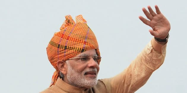 Indian Prime Minister Narendra Modi waves after delivering his Independence Day speech from The Red Fort in New Delhi on August 15, 2015.  Prime Minister Narendra Modi warned that corruption was eating away at India 'like a termite' as he used an independence day speech to pledge his commitment to eradicating graft and poverty. In an address from the ramparts of Delhi's Red Fort, Modi sought to silence growing doubts about his leadership after key reforms stalled in a rancorous parliament session dogged by allegations of corruption involving some of his top lieutenants.  AFP PHOTO/PRAKASH SINGH        (Photo credit should read PRAKASH SINGH/AFP/Getty Images)