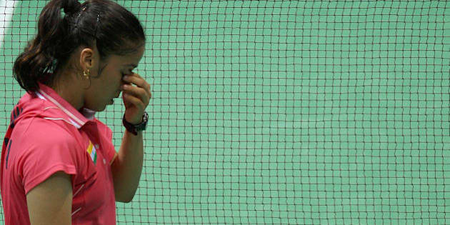 India's Saina Nehwal reacts after losing a point to Indonesia's Maria Kristina Yulianti during their women's singles quarter-final badminton match for the 2008 Beijing Olympic Games at the Beijing University of Technology Gymnasium on August 13, 2008. AFP PHOTO/Indranil MUKHERJEE (Photo credit should read INDRANIL MUKHERJEE/AFP/Getty Images)