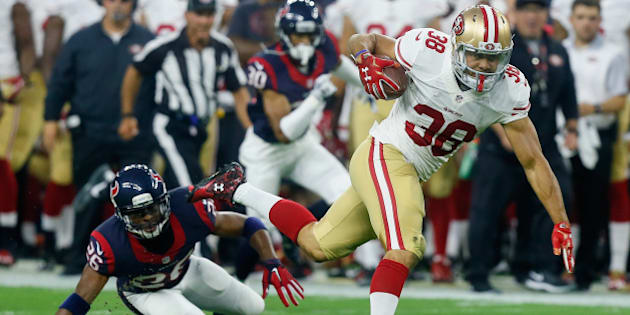 HOUSTON, TX - AUGUST 15:  Jarryd Hayne #38 of the San Francisco 49ers breaks the tackle attempt of Rahim Moore #26 of the Houston Texans in the first half at Reliant Arena at Reliant Park on August 15, 2015 in Houston, Texas.  (Photo by Bob Levey/Getty Images)