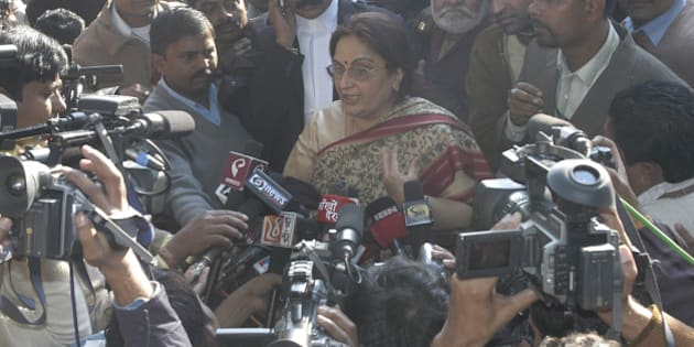 INDIA - DECEMBER 19:  Neelam Katara, mother of Nitish Katara, speaks to media persons just after the court's judgment in which Manu Sharma was found guilty in the Jessica Lal murder case at the Delhi High Court premises, New Delhi.  (Photo by Imtiyaz Khan/The India Today Group/Getty Images)