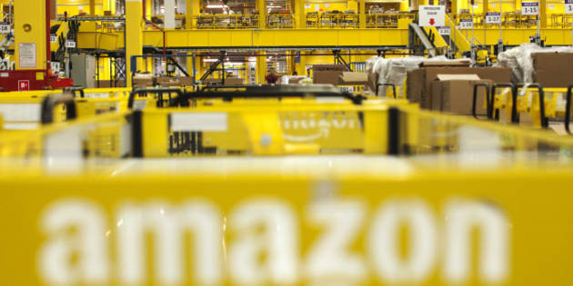 The logo for amazon.com inc. sits on a cart parked in the in-bound area at the Amazon.com Inc. fulfillment center in Poznan, Poland, on Friday, June 12, 2014. Amazon is the largest distributor of e-books in Europe, where the product's popularity has experienced a surge in recent years. Photographer: Bartek Sadowski/Bloomberg via Getty Images