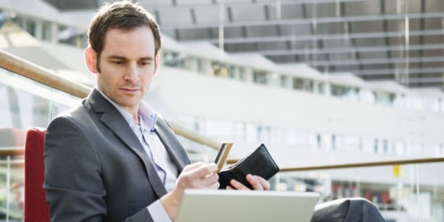Businessman with laptop and wallet