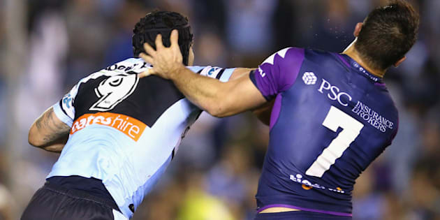SYDNEY, AUSTRALIA - AUGUST 17: Michael Ennis of the Sharks pushes away Cooper Cronk of the Storm as they scuffle during the round 23 NRL match between the Cronulla Sharks and the Melbourne Storm at Remondis Stadium on August 17, 2015 in Sydney, Australia.  (Photo by Mark Kolbe/Getty Images)