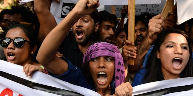 Indian students from the Film and Television Institute of India (FTII), along with other student activists, chant slogans during a protest against the appointment of Gajendra Chauhan as the chairman of the FTII, in New Delhi on August 3, 2015. Protesters are demanding the removal of Chauhan, who they say is not qualified for the post but was given the position due to political reasons, and have been boycotting their classes at the institute over the issue since June 12. AFP PHOTO / SAJJAD HUSSAIN        (Photo credit should read SAJJAD HUSSAIN/AFP/Getty Images)