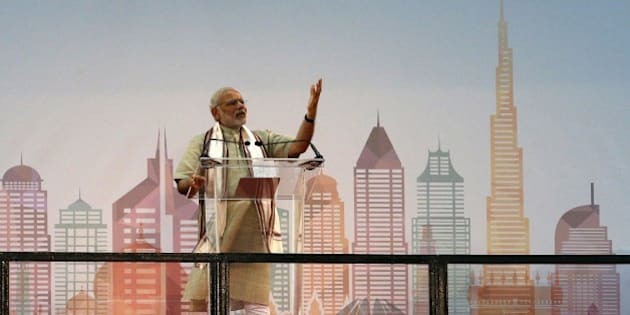 Indian Prime Minister Narendra Modi delivers a speech to members of the Indian expatriate community in the United Arab Emirates at the Dubai Cricket Stadium, on August 17, 2015, during a two-day visit to the UAE. Modi is the first Indian premier to visit the UAE in more than three decades since Indira Gandhi came in 1981 and is due to address the country's large India expat community in Dubai. Indians, who form the UAE's largest expatriate community, account for about 30 percent of the country's population of eight million, with many of them labourers who were behind the construction boom.  AFP PHOTO / KARIM SAHIB        (Photo credit should read KARIM SAHIB/AFP/Getty Images)