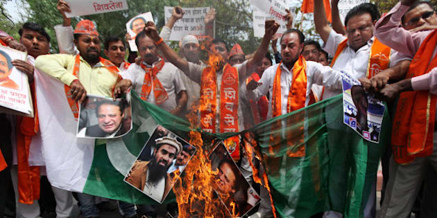 Hindu right-wing Shiv Sena activists burn a Pakistani flag along with posters of Pakistani Prime Minister Nawaz Sharif and suspected mastermind of the deadly Mumbai attacks in 2008 Zaki-ur-Rehman Lakhvi, center, after Lakhvi was released on bail by a Pakistani court, in New Delhi, India, Saturday, April 11, 2015. The release of Lakhvi, who has been held since his arrest in 2009, drew expressions of concern from both India and the United States. Lakhvi has been described as the operations chief for Lashkar-e-Taiba, the group blamed for the series of bombings and shootings in the heart of the Mumbai that killed 166 people. (AP Photo/Altaf Qadri)