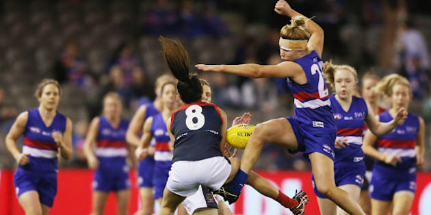 MELBOURNE, AUSTRALIA - AUGUST 16:  Kellie Gibson (R) of the Bulldogs collides with and tumbles over Britany Bonnici of the Demons during a Women's AFL exhibition match between Western Bulldogs and Melbourne at Etihad Stadium on August 16, 2015 in Melbourne, Australia.  (Photo by Michael Dodge/Getty Images)