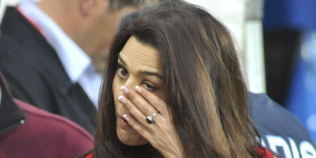 Bollywood star Preity Zinta wipes a tear from her eye after hearing that two of IPL Punjab Kings players Jawardne and Sangakara were injured in a terrorist shooting in Pakistan while she was attending the New Zealand and India 1st one day international cricket match at McLean Park, Napier, New Zealand, Tuesday, March 3, 2009. A dozen masked gunmen armed with rifles and rocket launchers attacked the Sri Lankan cricket team as it traveled to a match in Pakistan on Tuesday, wounding several players and killing five police officers, officials said. (AP Photo/NZPA, Ross Setford) ** NEW ZEALAND OUT **