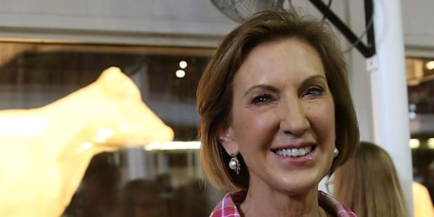 DES MOINES, IA - AUGUST 17:  Republican presidential candidate Carly Fiorina poses for a photo in front of the Butter Cow while touring the Iowa State Fair on August 17, 2015 in Des Moines, Iowa.  Presidential candidates are addressing attendees at the Iowa State Fair on the Des Moines Register Presidential Soapbox stage and touring the fairgrounds. The State Fair runs through August 23.  (Photo by Justin Sullivan/Getty Images)