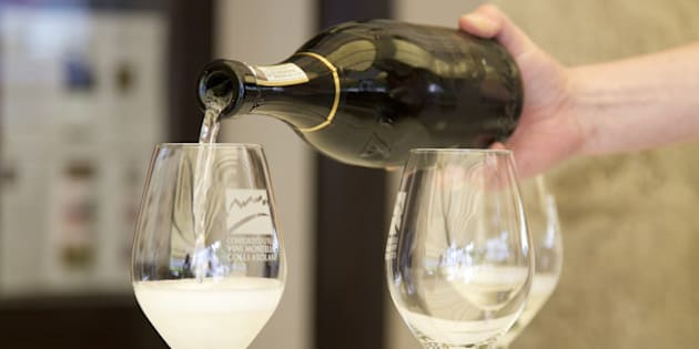 Italy, Asolo, pouring two glasses of prosecco