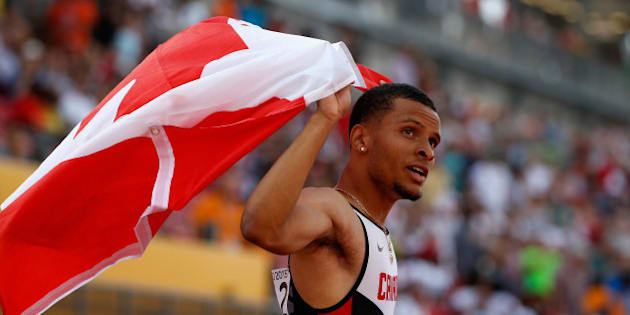 TORONTO, ON - JULY 24:  Andre De Grasse of Canada holds the Canadian flag after winning the men's 200 meter final on Day 14 of the Toronto 2015 Pan Am Games on July 24, 2015 in Toronto, Canada.  (Photo by Ezra Shaw/Getty Images)